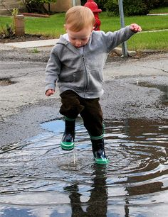 Little Boy in Puddle
